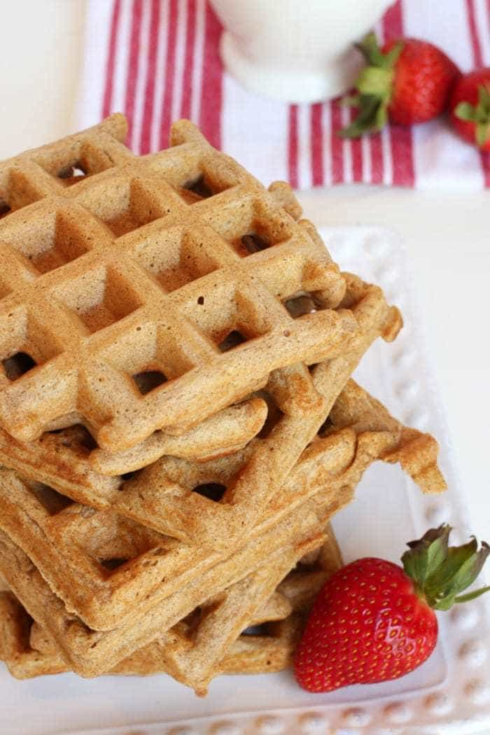 Homemade whole food honey whole wheat waffles make the perfect breakfast! Wholesome and filling!