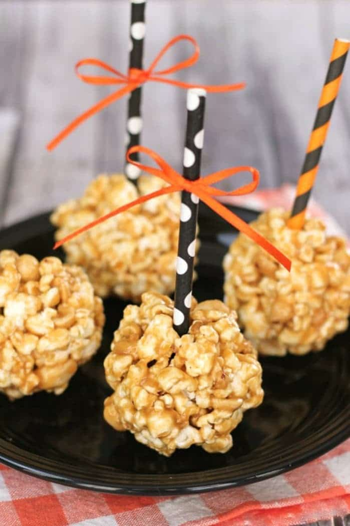 These all natural peanut butter popcorn balls are perfect for your next party! They have no refined sugar and are fun to make!