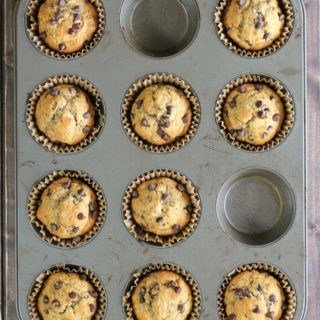 Whole wheat banana muffins with chocolate chips make a healthy choice for snack time or breakfast! Make a bunch and pop them in the freezer.