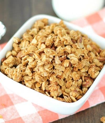 This crunchy pumpkin granola with pecans is the perfect way to start a fall morning! It's delicious in a bowl with milk or on top of Greek yogurt.