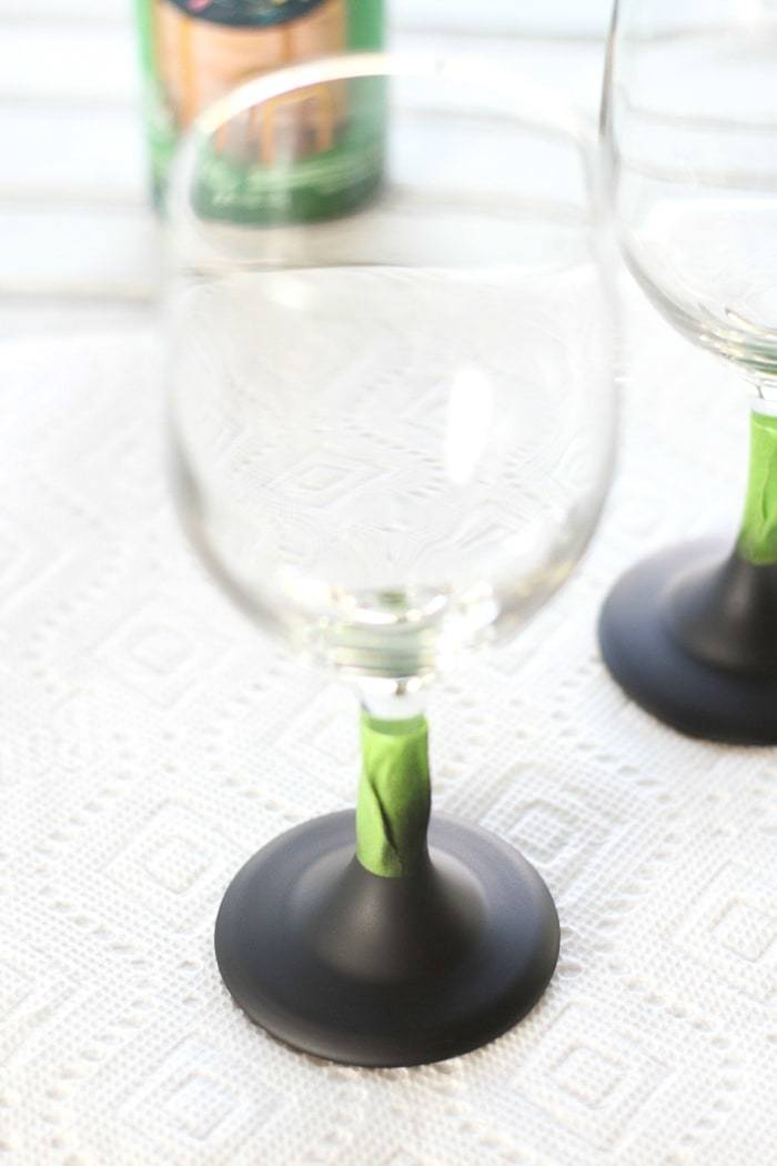 DIY tutorial to make your own chalkboard wine glasses! Add a personal touch and never lose your glass at a party again!