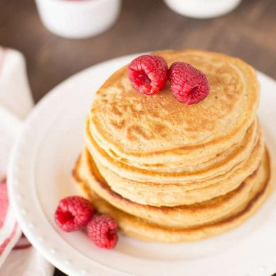 Light and fluffy whole wheat pancakes with raspberries!