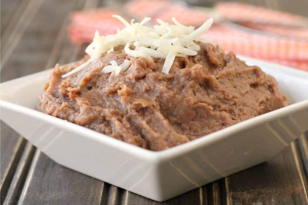 Homemade refried style beans in the Crock-Pot! Now you can enjoy a healthier alternative to canned refried beans!