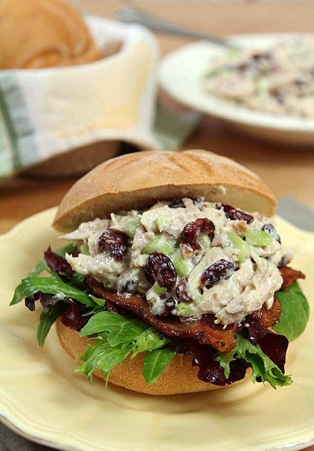 My version of a classic sandwich from an iconic Chicago Department Store. Roasted chicken is combined with dried cranberries and nuts in a mayo and sour cream dressing and it's all topped with crisp bacon. Perfect for National Sandwich Day!