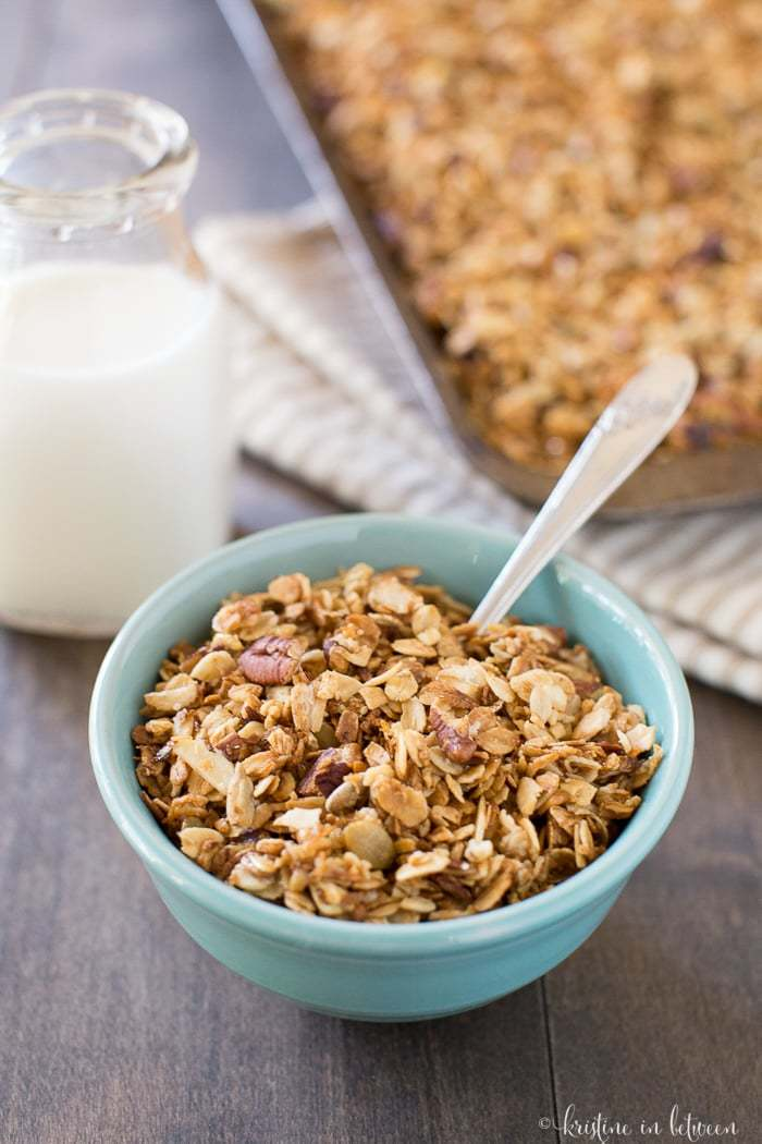 Lightly sweet and crunchy everyday granola made with oats, pumpkin seeds, almonds, pecans, honey, and maple syrup. The perfect whole food way to start the day!