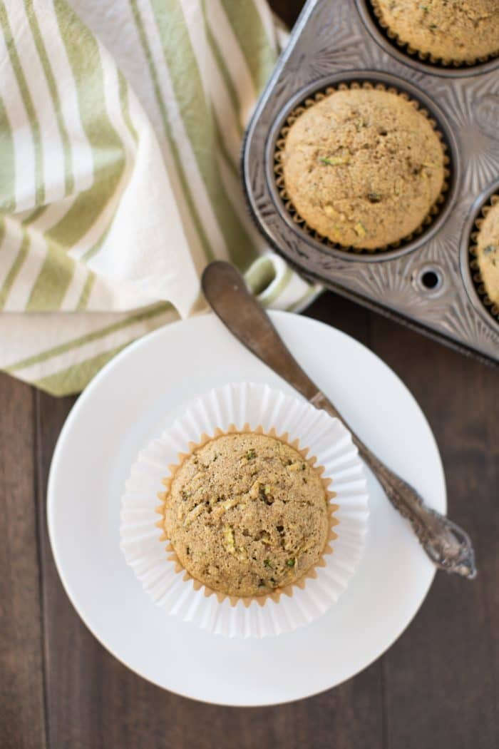 Homemade whole wheat zucchini muffins! Soft and fully of flavor, the perfect way to use up all of those summer zucchinis!