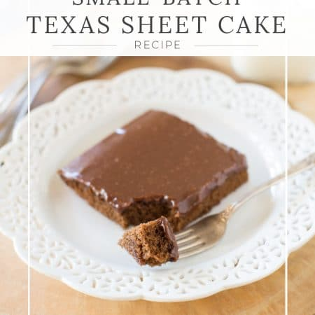 A piece of Texas sheet cake sitting on a white plate with a fork
