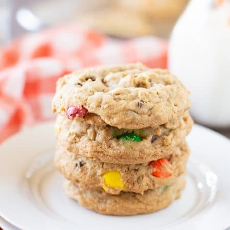 Thick and chewy monster cookies that you can make in less than 30 minutes! They're loaded with chocolate and peanut butter goodies!