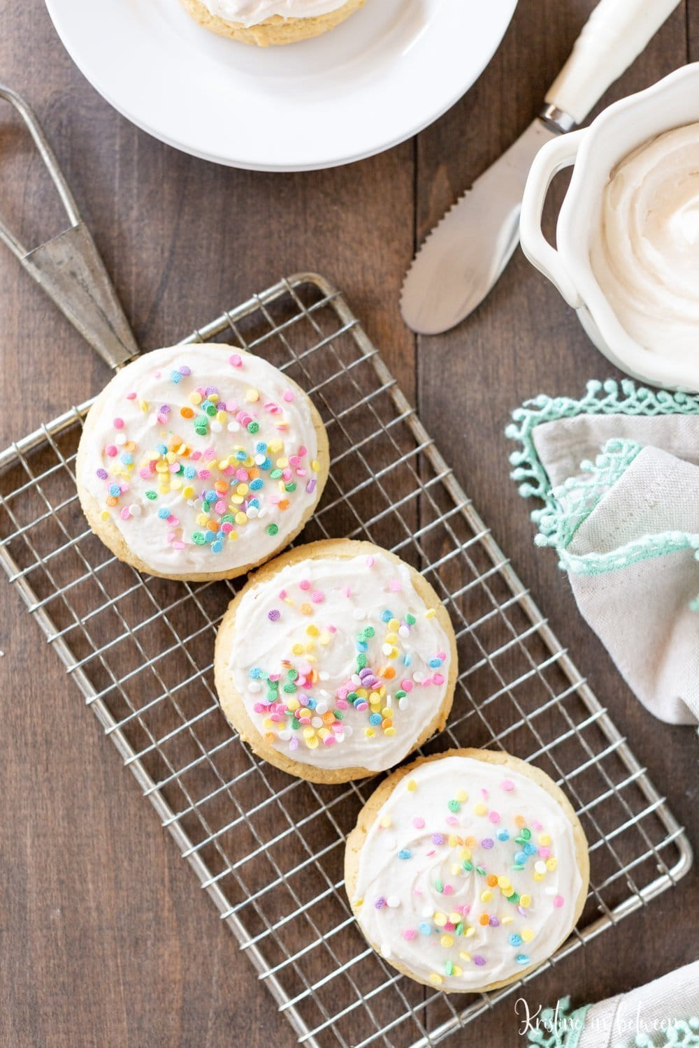 This soft sugar cookie recipe is a must-bake for the holidays! The cookies are light and fluffy, making them perfect for buttercream frosting and sprinkles!