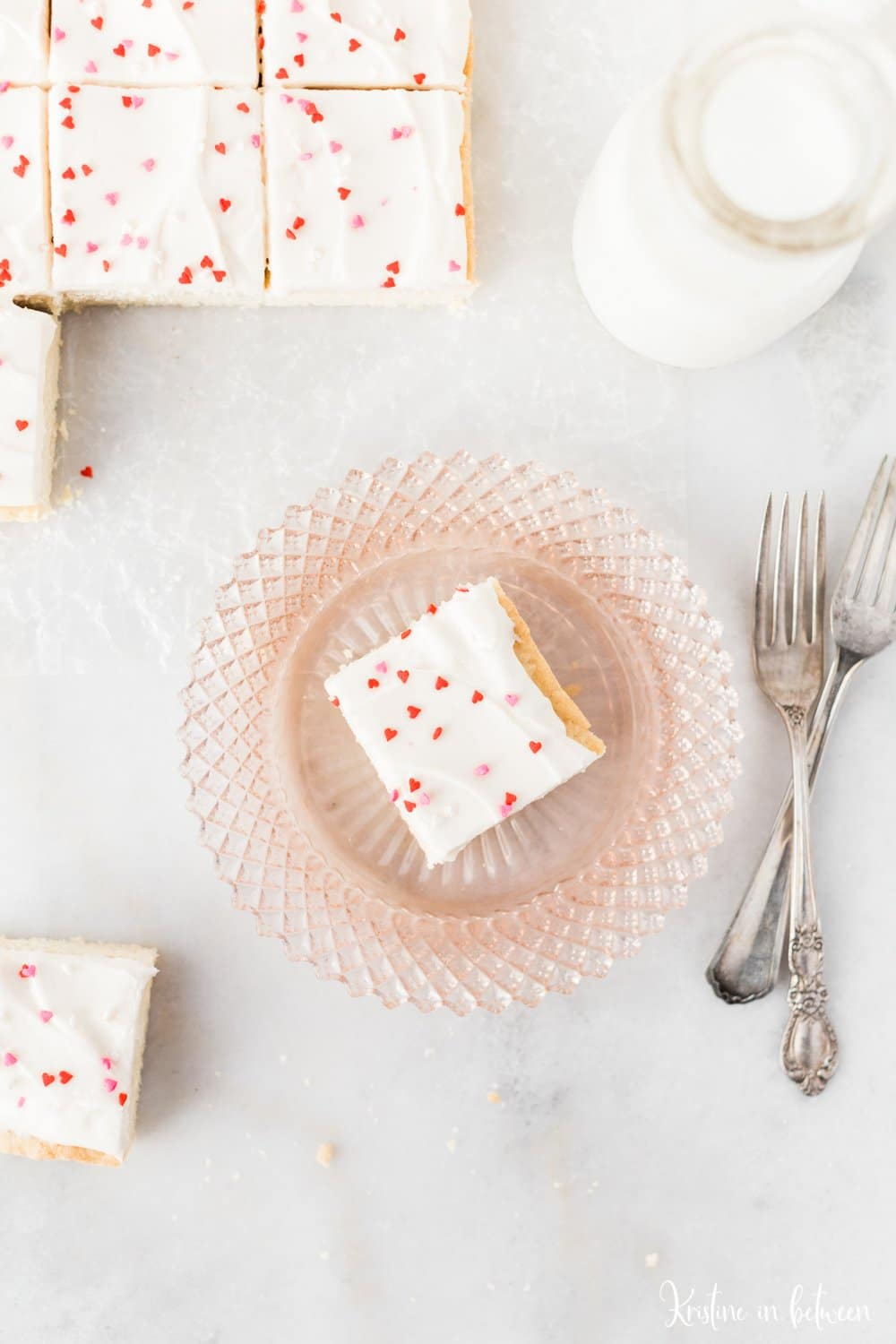Super easy small batch sugar cookie bars with cream cheese frosting!