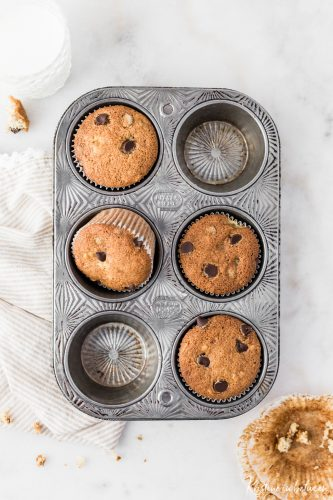 Super easy everyday chocolate chip banana bread muffins! They're light and fluffy and loaded with chocolate!