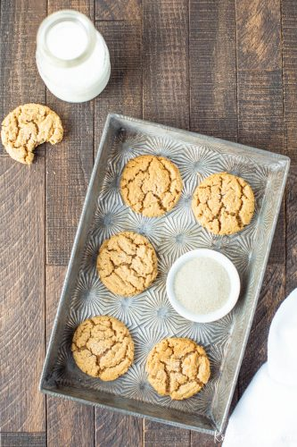 Flourless peanut butter cookies sitting in a tin with a white napkin
